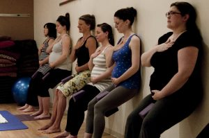 Pregnanct women doing yoga together